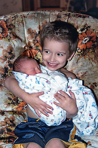 Jesse holding his new brother